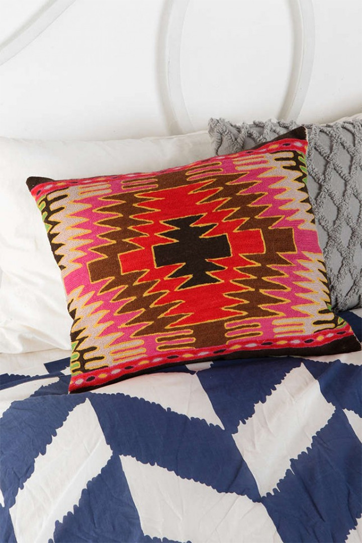 A decorative pillow is just that: decorative. They really don't serve any purpose except for the occasional living room blanket fort and maybe a footrest during a movie marathon. We don't really need them, yet every season we start swooning over the new colors, patterns and shapes that are practically begging to be tossed on our sofa. Summer is an especially exciting time to update your decor with bright colours and a fresh new look. The cheapest way to do that? With a few new pillows, of course. See, we are practically saving you money by showing you these summery, must-have pillows ;)